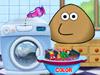 Pou стирает одежду